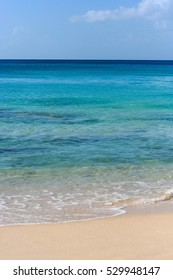 Different tones of blues in a warm white sand beach