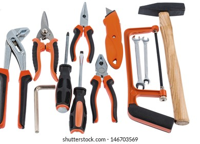 different tools of a craftsman lie side by side on white background