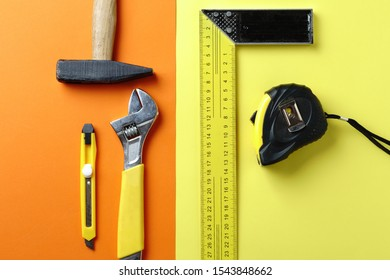 Different tools, hammer, tape measure, key, on a colorful background
