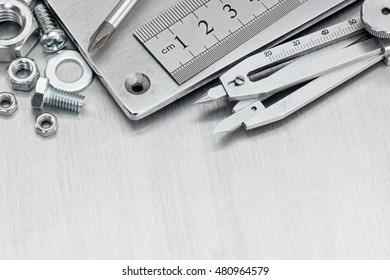 different tools for house renovation and hand work on metal table background