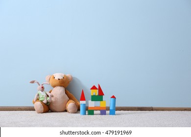 Different toys on blue wall background