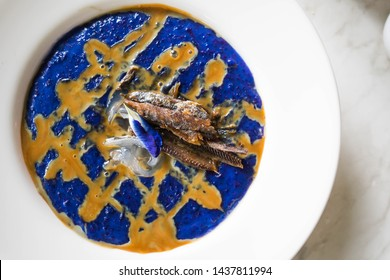different twist of ube champorado with dried fish on top