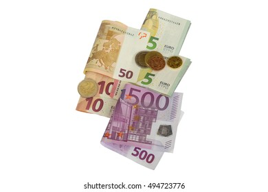 Different type of Euro Currency coins on folded banknotes, a set of money 5, 10, 50, 500 isolated on white background