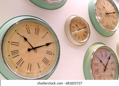 Different type of retro style wall clocks on the wall