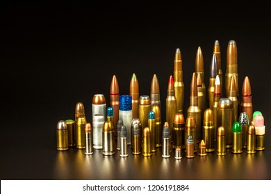 Different types of ammunition on a black background. Sale of weapons and ammunition. The right to hold a gun