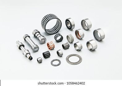Different types of automotive bearings in white background
