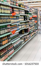 Different types of beer on the shelves in the supermarket