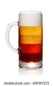 Different types of beer shown in one mug isolated on white background. With clipping path