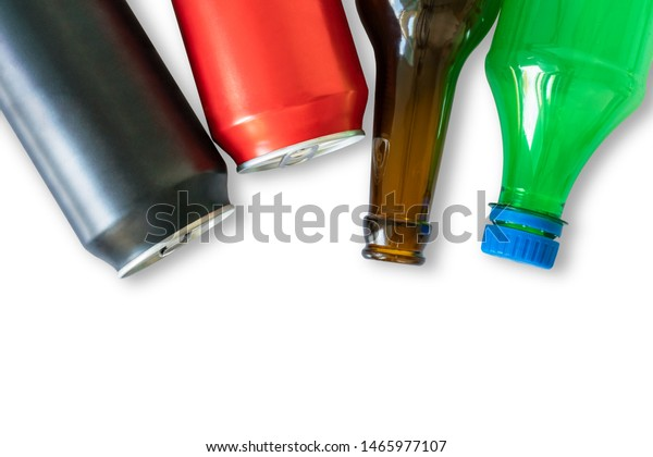 Different types of bottles for recycling. Metal aluminium black and red cans, dark glass and green plastic bottle isolated on a white background with copy space for text