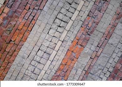 Different types of bricks and paving stones on a wall