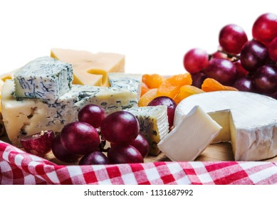 different types of cheese with nuts and fruits isolated on white background