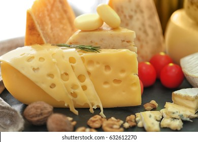 Different types of cheese on table, closeup