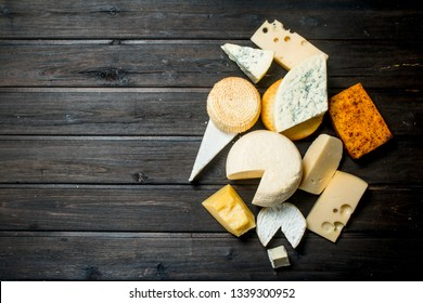 Different types of cheese. On a wooden background.