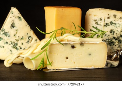 Different types of cheeses on the kitchen table. Preparation of snacks. Healthy food