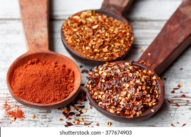 Different types of chilli flakes and paprika