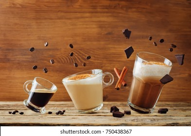 Different types of coffee with flying ingredients. Espresso, cappuccino and mocha coffee. toning. selective focus