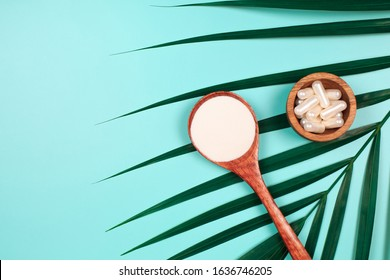 Different types of collagen on palm leaf. Powder, capsules, tablets and fluid.