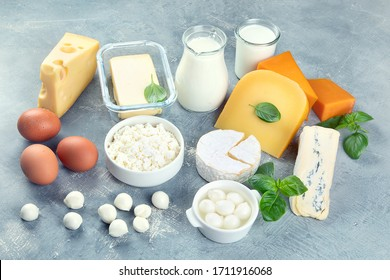 Different types of dairy products on grey background.