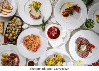 Different types of dishes on the table, top view. Concept for restaurant menu.
