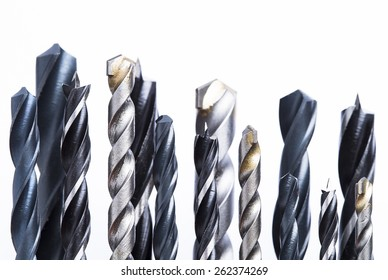 Different types of drill bits isolated on white background