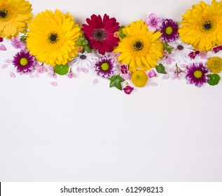 Different types of flowers on a white background with space for copy