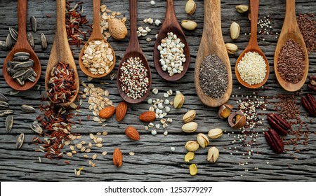 Different types of grains and cereals on shabby wooden background