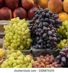 Different types of grapes on the shelves of the farmer's market, open shelves, showcases. Healthy organic food. Autumn harvest
