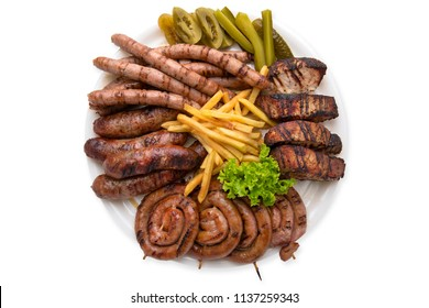 Different types of grilled meat. Assorted sausages. Isolated on white. View from above.