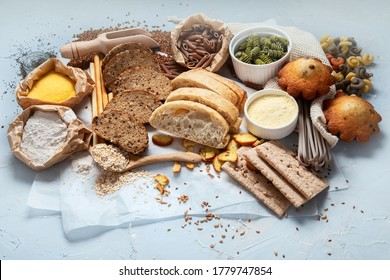 Different types of high carbohydrate food. Selection of good sources of carbs on grey background.