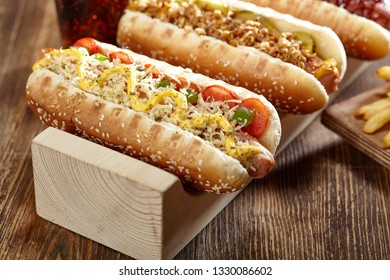 Different types of Hot Dogs With Yellow Mustard, Onion, Pickles with French Fries