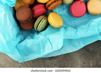 Different types of macaroons or macarons in a box.