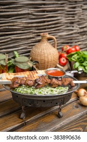 Different types of meat prepared on grill with vegetables