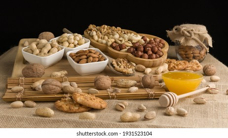 Different types of nuts, nuts in honey, nuts in slowmo, honey
