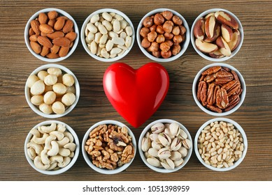 Different types of nuts in small bowls. Healthy food concept