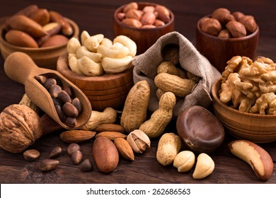 Different types of nuts: walnut, hazelnut, cashew, peanuts; brazil , pine and other