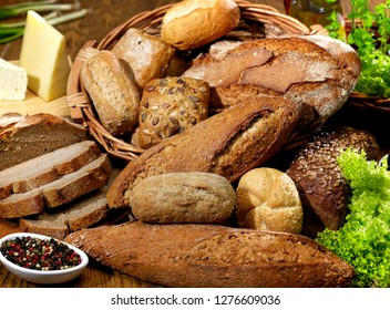 Different types on bread on wood