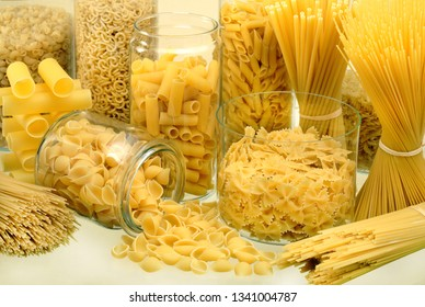 Different types of pasta in glass jars / pasta shapes
