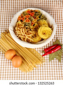 Different types of pasta on checkered background