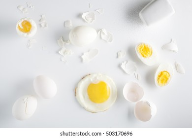 Different types of prepared eggs on white background. Overhead view