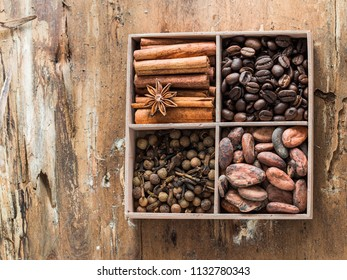 Different types of spice. Coffee, cacao beans,pepper, cinnamon in wooden box. top view