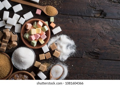 different types of sugar on wooden background
