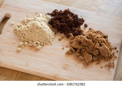 Different types of suger - dark brown soft, light brown soft & molasses - natural unrefined cane sugar.