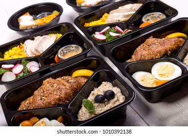 Different types of takeaway food in microwavable containers. Fresh and healthy meal for fitness and bodybuilding.