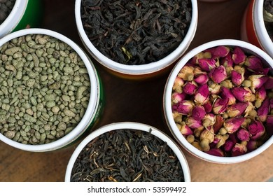 Different types of tea in small round tea boxes