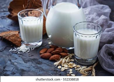 Different types of vegan lactose-free milk.  Selective focus