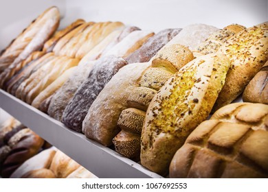different varieties of bread from different flour on the bakery counter