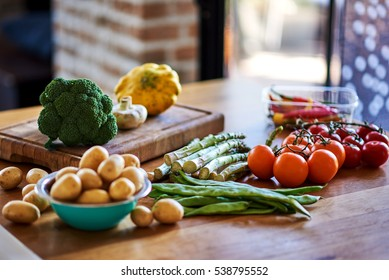 Different vegetables and greens. Organic products and healthy lifestyle. Fresh food on the wooden background.