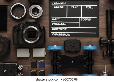 different video making equipment for indie production on brown wooden table view from above. short movie production essentials