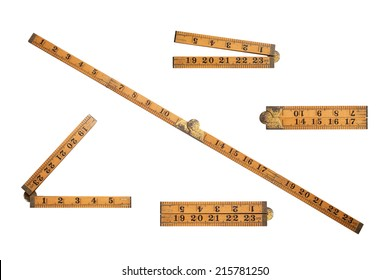 Different views of an old wooden folding ruler as used by carpenter Isolated on white with clipping path