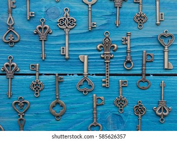 Different vintage keys on a wooden surface